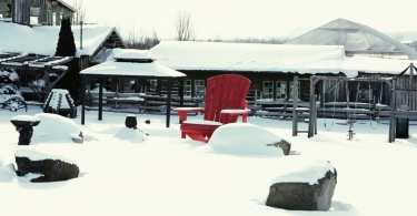 Red chair on snow thumbnail